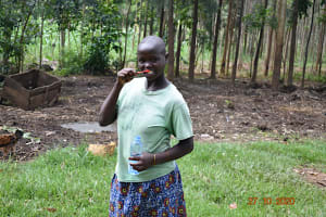 The Water Project: Mahola Community, Oyula Spring -  Volunteer Demonstrates Toothbrushing