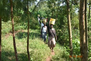The Water Project: Mahola Community, Oyula Spring -  Women Carrying Materials To The Construction Site