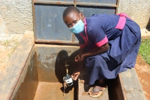 The Water Project: Jinjini Friends Primary School -  Collecting Water
