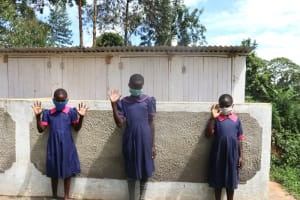 The Water Project: Jinjini Friends Primary School -  Girls At The Latrines