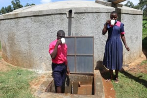 The Water Project: Jinjini Friends Primary School -  Students Drinking Water At The Tank