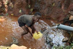 The Water Project: Shikoye Community, Kwa Witinga Spring -  Bravine Collecting Water