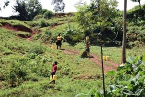 The Water Project: Shikoye Community, Kwa Witinga Spring -  Carrying Water