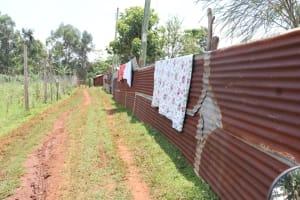 The Water Project: Shikoye Community, Kwa Witinga Spring -  Clothes Drying On Fence
