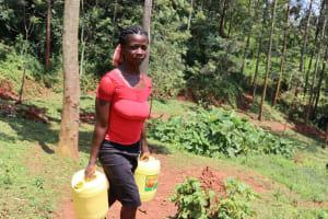 The Water Project: Shikoye Community, Kwa Witinga Spring -  Rita Carrying Water