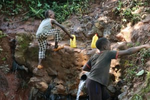 The Water Project: Shikoye Community, Kwa Witinga Spring -  Climbing Out Of The Spring