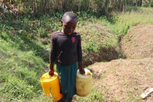 The Water Project: Shisasari Itumbu Community, Mathias Juma Spring -  A Girl Carrying Water From The Spring