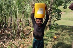The Water Project: Shisasari Itumbu Community, Mathias Juma Spring -  A Girl Carrying Water Home