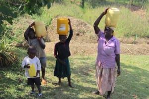 The Water Project: Shisasari Itumbu Community, Mathias Juma Spring -  Carrying Water Home