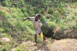 The Water Project: Shisasari Itumbu Community, Mathias Juma Spring -  Justus Leaving The Spring