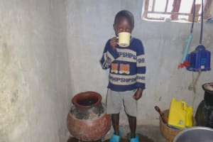 The Water Project: Malimali Community, Onyango Spring -  Taking A Drink