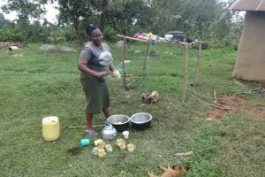 The Water Project: Malimali Community, Onyango Spring -  Washing Utensils