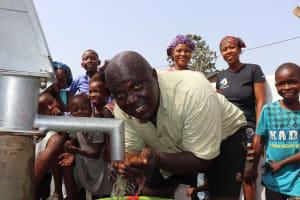 The Water Project: Lungi, New London, #10 Dankama Street -  Community Members Drinking Water