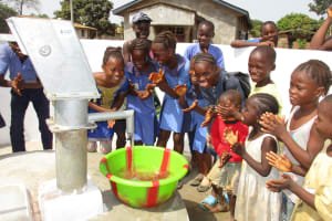 The Water Project: Lungi, New London, #10 Dankama Street -  Kids Celebrating Clean Water Flowing