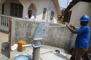 The Water Project: Lungi, New London, #10 Dankama Street -  Staff Collecting Water After Installing Pump