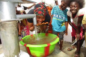 The Water Project: Lungi, New London, #10 Dankama Street -  Woman Happy Drinking Water