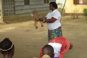 The Water Project: Lungi, Mahera, #5 MacAuley Street -  Hygiene Facilitator Teaching About Diarrhea