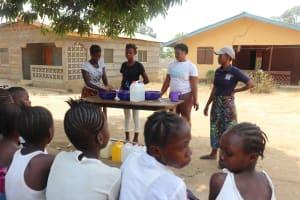 The Water Project: Lungi, Mahera, #5 MacAuley Street -  Demonstrating Bowl Handwashing Method