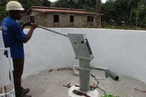 The Water Project: Lungi, Mahera, #5 MacAuley Street -  Staff Collecting Water After Installing Pump