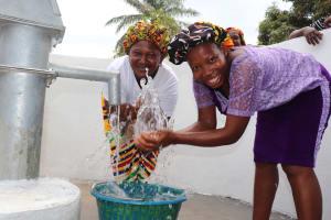The Water Project: Lungi, Mahera, #5 MacAuley Street -  Happy Women Splashing Water