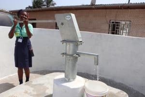 The Water Project: Lungi, Tardi, Khodeza Community School -  Student Happy Collecting Water