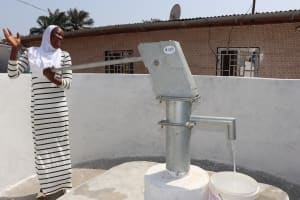The Water Project: Lungi, Tardi, Khodeza Community School -  Teacher Collecting Safe Drinking Water