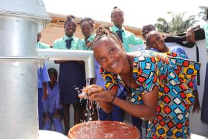 The Water Project: Lungi, Tardi, Khodeza Community School -  Teacher Happy Drinking Water