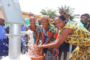 The Water Project: Lungi, Tardi, Khodeza Community School -  Teachers Happy Splashing Water