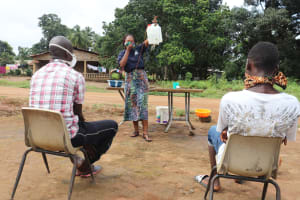The Water Project: Lungi, Kambia, #6 Bangura St. -  Hygiene Facilitator Teaching About Tippy Taps