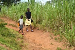 The Water Project: Mundoli Community, Pamela Atieno Spring -  Children Head To Fetch Water