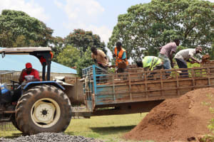 The Water Project: Friends Kisasi Secondary School -  Community Delivers Local Materials