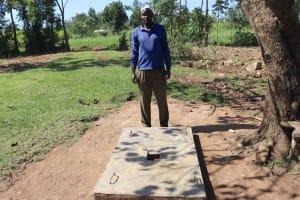 The Water Project: Mahira Community, Anunda Spring -  Jeremiah Happy About His Sanplat