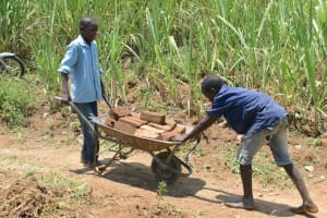 The Water Project: Shitavita Community, Patrick Burudi Spring -  Boys Bring Bricks To Spring Site