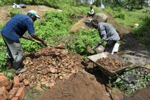 The Water Project: Silungai B Community, Tali Saya Spring -  Community Members Mix Materials