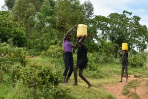 The Water Project: Mundoli Community, Pamela Atieno Spring -  Children Helping Each Other Lift Water