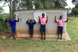 The Water Project: Kapkoi Primary School -  Boys Cebrate Next To Their Latrines