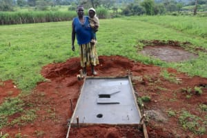 The Water Project: Nguvuli Community, Busuku Spring -  Elinah Musalia With Her Completed Sanitation Platform