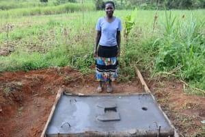 The Water Project: Nguvuli Community, Busuku Spring -  Mary Busuku With Her Completed Sanitation Platform