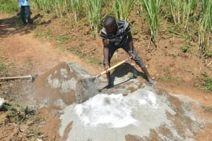 The Water Project: Shitavita Community, Patrick Burudi Spring -  Mixing Mortar