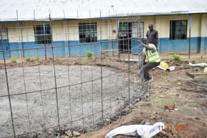 The Water Project: Isango Primary School -  Fitting The Wire To The Foundation