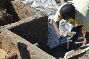 The Water Project: Shitavita Community, Patrick Burudi Spring -  Plastering Inner Walls
