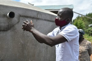 The Water Project: Ivakale Primary School & Community - Rain Tank 1 -  Erick Demonstrates Cleaning The Guaze
