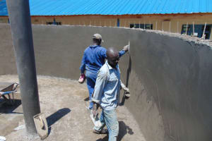 The Water Project: Kinu Friends Secondary School -  Applying Final Plaster Coat