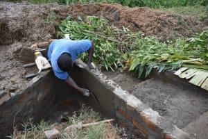 The Water Project: Shitavita Community, Patrick Burudi Spring -  Plastering Outer Walls