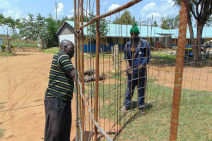 The Water Project: Ivakale Primary School & Community - Rain Tank 1 -  Reinforcing The Wire Mesh With Rebar