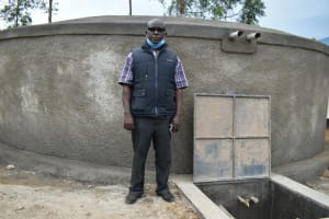 The Water Project: Kinu Friends Secondary School -  Principal Viincent Okoth At The Rain Tank