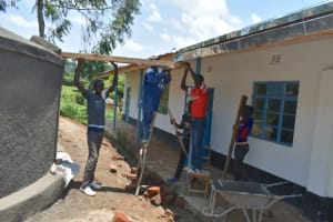The Water Project: Kinu Friends Secondary School -  Setting Up The Gutters