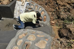 The Water Project: Shitavita Community, Patrick Burudi Spring -  Finishing Drainage Channel