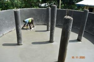 The Water Project: Isango Primary School -  Plastering The Tank Floor