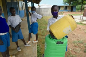 The Water Project: Ivakale Primary School & Community - Rain Tank 1 -  Oscar Shows How To Refill The Handwashing Station